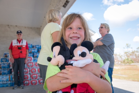 Emma Cribbs, age 6 of Mexico Beach hits the Mother Load of Mickeys at a Red Cross Pod on California and 15th. Emma's family suffered water damage and lost a vehicle during Michael.